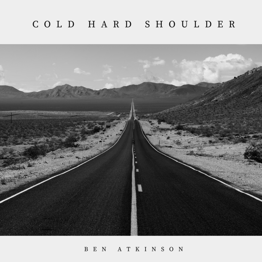 A long straight country road, running through the desert. The Album cover for Ben's album Cold Hard Shoulder.