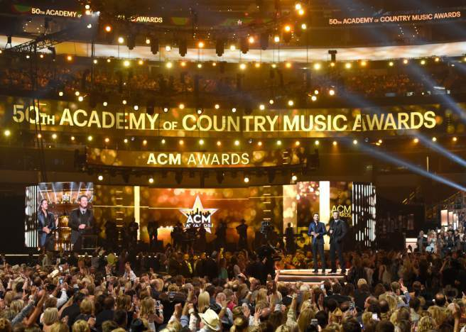 ACM Awards taking place in Las Vegas, a big awards show in an arena.